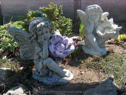 "Fairy Sitting w/flower #7506 15.5""H x 11""W"